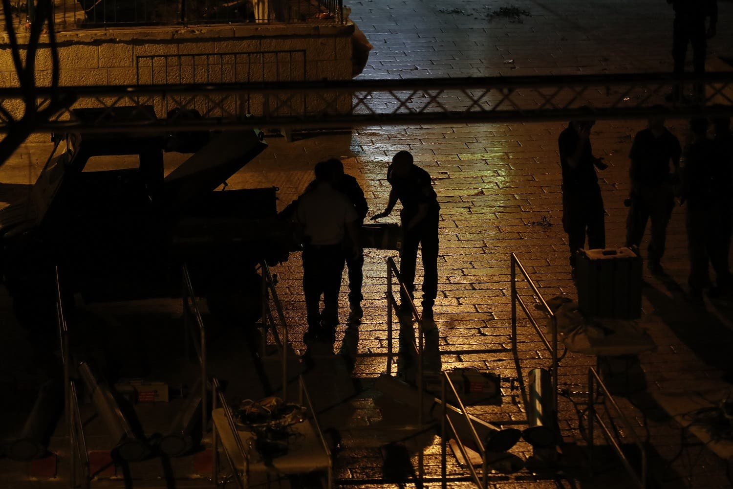 Israeli security forces take down security barriers at the Lions' Gate on July 24, 2017. (AFP)
