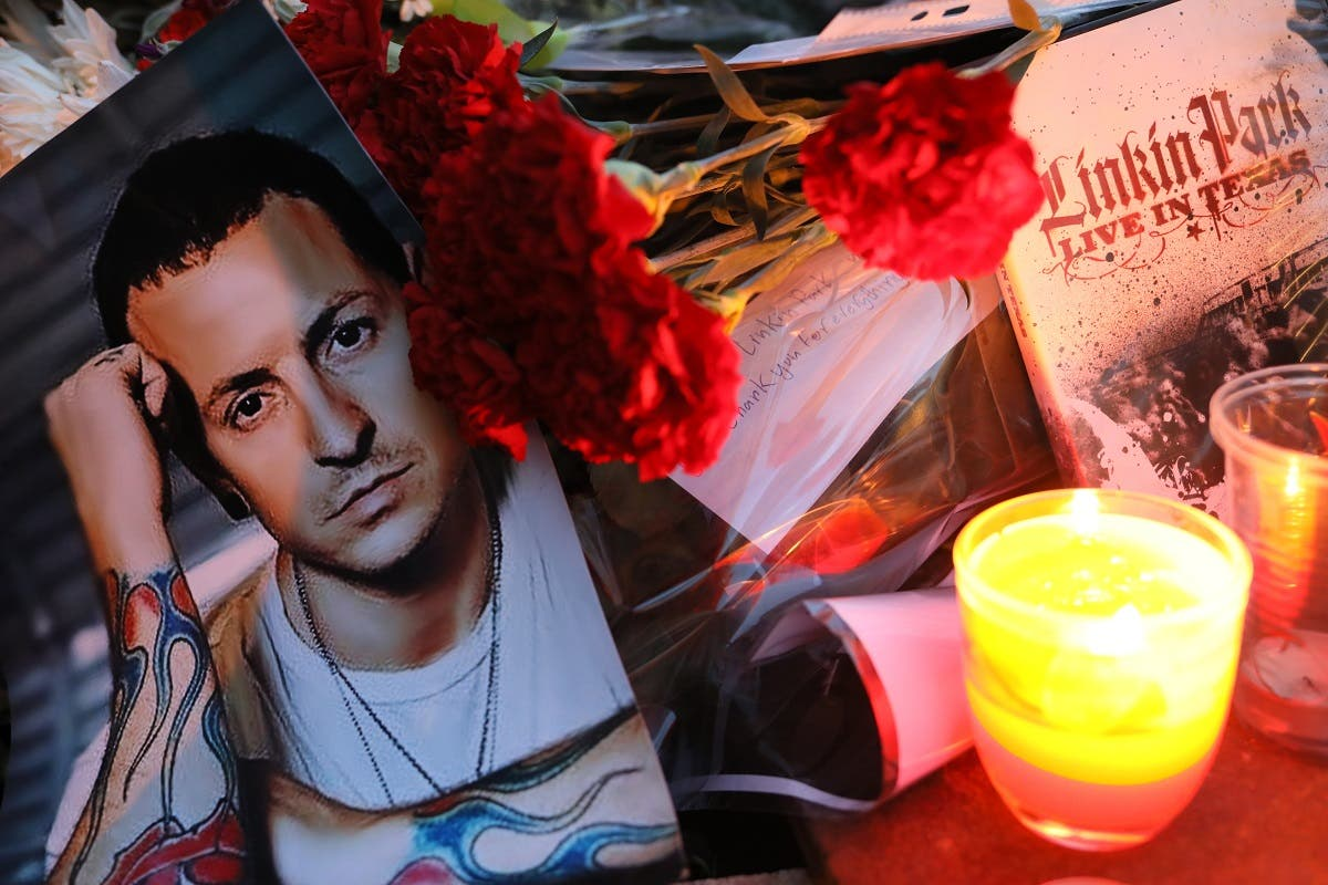 Flowers and candles seen outside the US Embassy in Moscow in memory of the band's lead singer Chester Bennington, who was found dead from suicide in his house. (Shutterstock)