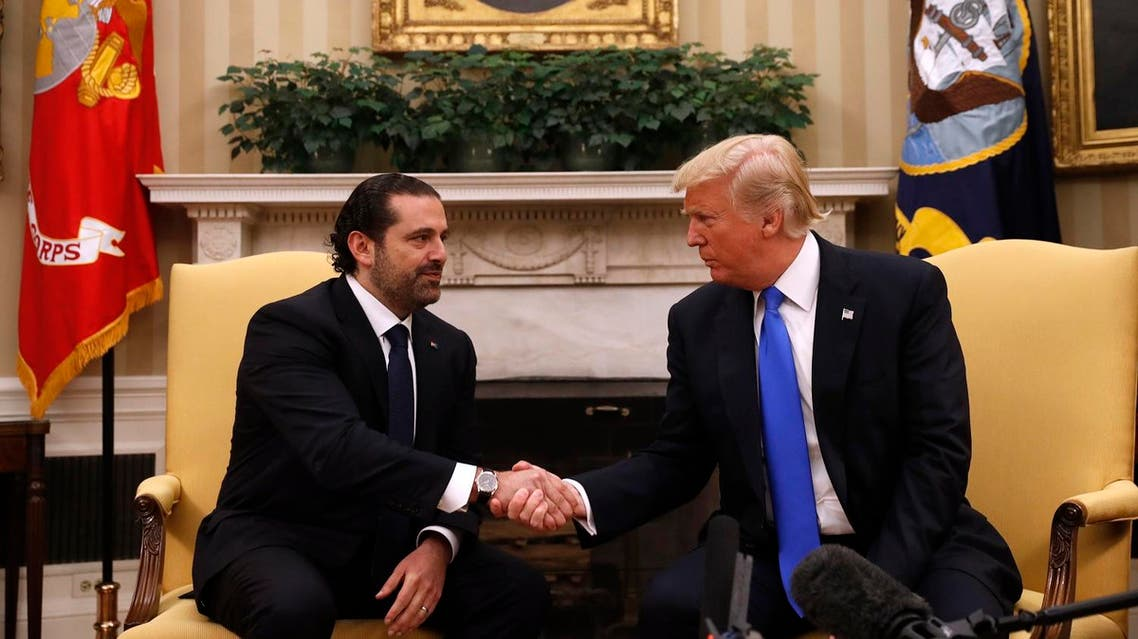 President Donald Trump shakes hands with Lebanese Prime Minister Saad Hariri during their meeting in the Oval Office of the White House in Washington, Tuesday, July 25, 2017. (AP)