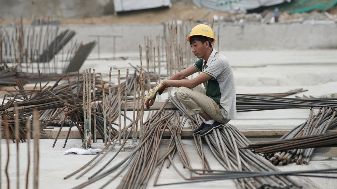 A laborer rests at a construction site in Beijing, China, on July 20, 2017. (Reuters)