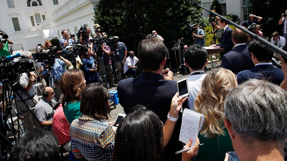 White House senior adviser Jared Kushner, at right, speak to the media outside the White House in Washington, Monday, July 24, 2017, after meeting behind closed doors with the Senate Intelligence Committee on the investigation into possible collusion between Russian officials and the Trump campaign. (AP Photo/Jacquelyn Martin)