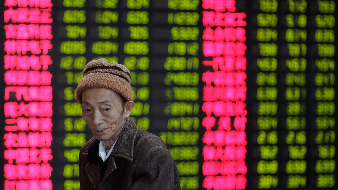An investor looks at the stock price monitor at a private securities company in Shanghai, China, Thursday, Nov. 8, 2012. (AP)