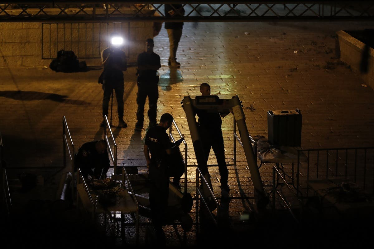 Israeli security forces take down security barriers near Lions' Gate, a main entrance to the Al-Aqsa mosque compound in Jerusalem. (AFP)