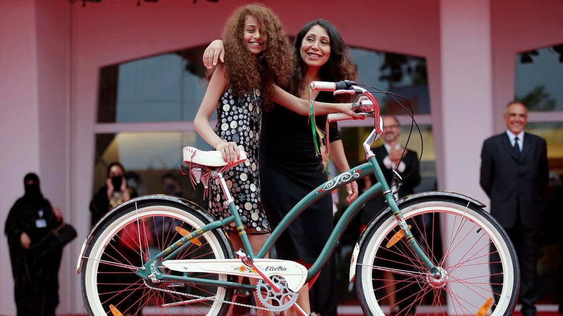 """Saudi Arabian director Haifaa al-Mansour (R) and actress Waad Mohammed pose with a bicycle on the red carpet during the premiere screening of """"Wadjda"""" during the 69th Venice Film Festival in Venice August 31, 2012. (Reuters)"""