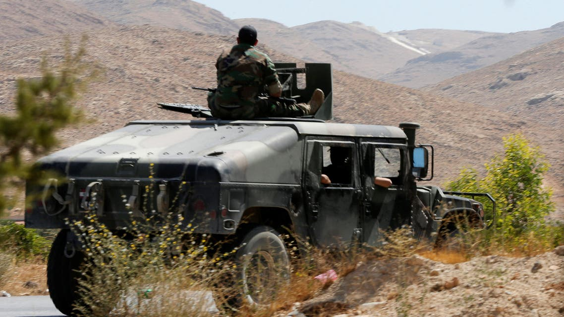 Lebanese army soldiers are seen inside a military vehicle in Labwe, at the entrance of the border town of Arsal, in eastern Bekaa Valley, Lebanon July 24, 2017