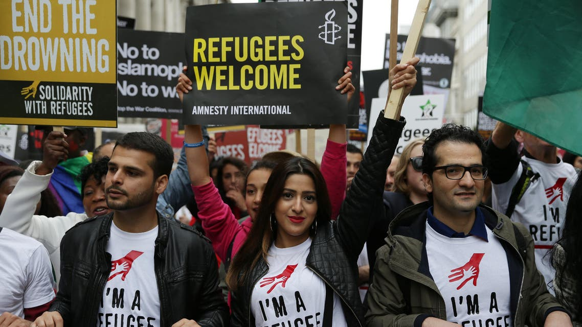 Demonstrators take part in a march calling for the British parliament to welcome refugees in the UK in central London on September 17, 2016. Thousands marched in central London calling on the British government to do more to help refugees fleeing conflict and persecution.
