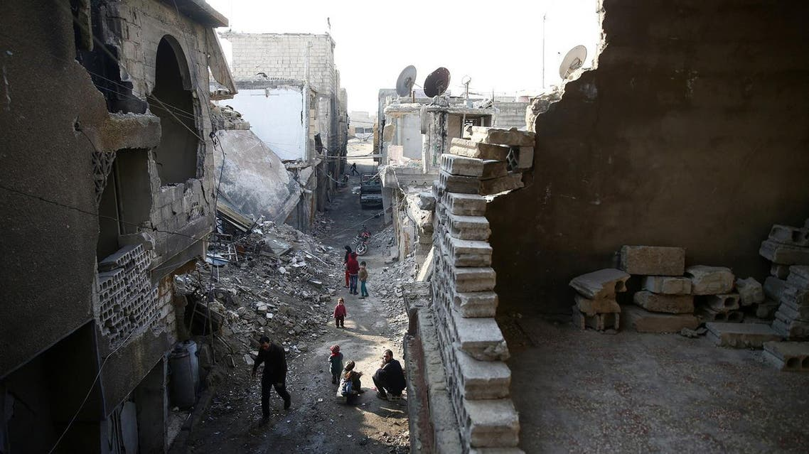 People walk in a damaged neighbourhood in the rebel held besieged city of Douma, in the eastern Damascus suburb of Ghouta, Syria January 19, 2017. REUTERS/Bassam Khabieh