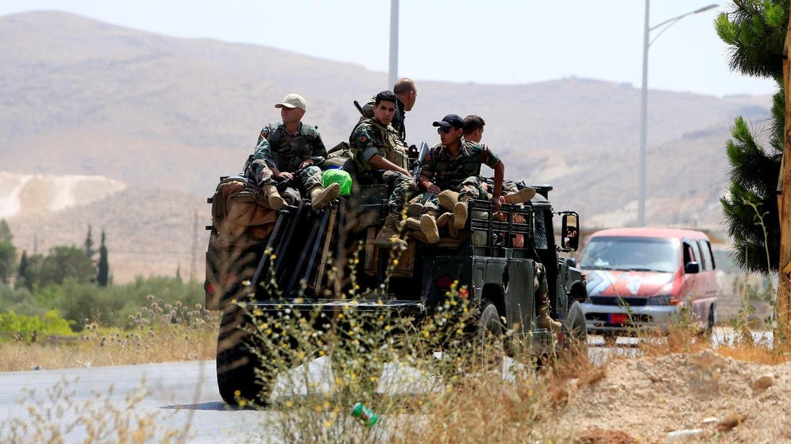 Lebanese army soldiers patrol a street in Labwe, at the entrance of the border town of Arsal, in eastern Bekaa Valley, Lebanon July 21, 2017. REUTERS/Ali Hashisho