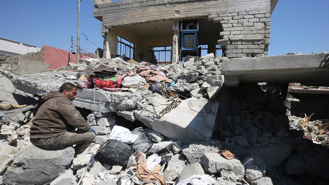 This file photo taken on March 26, 2017 shows an Iraqi man sitting amid the rubble of destroyed houses in Mosul's al-Jadida area on March 26, 2017. (AFP)