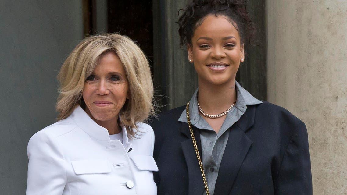 Brigitte Macron, left, the wife of French President Emmanuel Macron welcomes Singer Rihanna at the Elysee Palace to meet French President Emmanuel Macron in Paris, France, Wednesday, July 26, 2017.(AP)