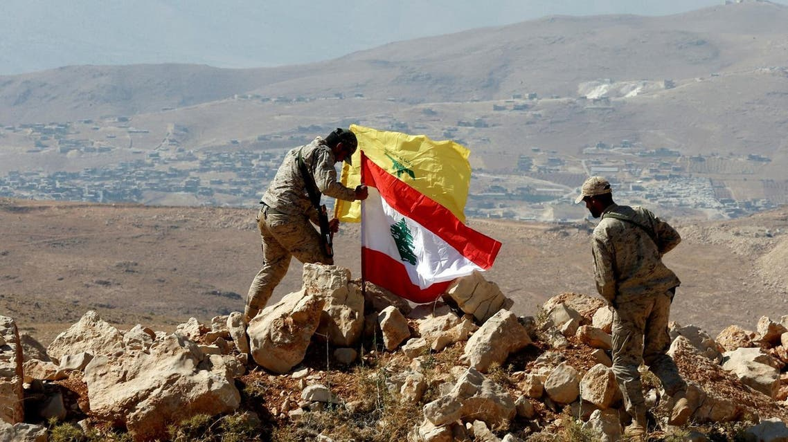 Hezbollah fighters put Lebanese and Hezbollah flags at Juroud Arsal, Syria-Lebanon border, on July 25, 2017. (Reuters)