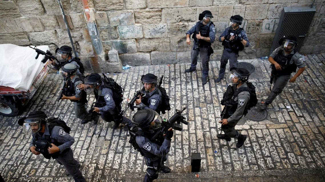 Israeli policemen guard a street at Jerusalem's Old city outside the Noble Sanctuary compound, after Israel removed all security measures it had installed at the compound on July 27, 2017. (Reuters)