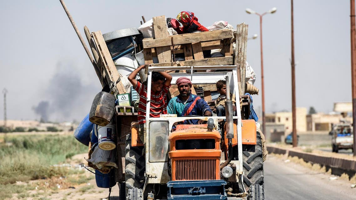 Syrians flee their homes on the frontline of Raqa on July 15, 2017, during an offensive by the Syrian Democratic Forces (SDF), to retake the city from ISIS. (AFP)