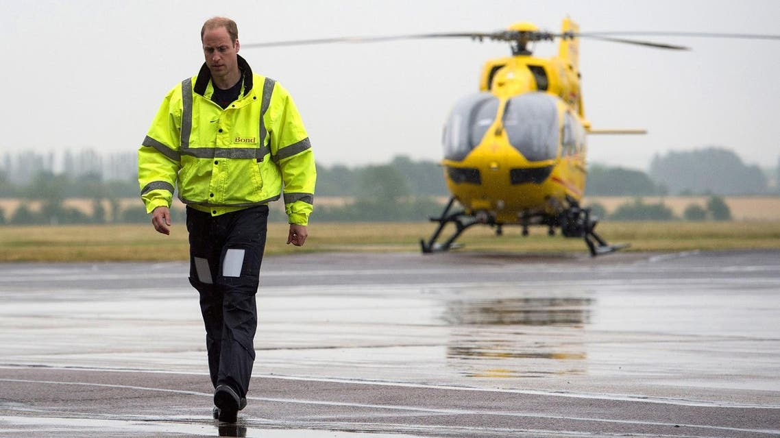 Prince William walks away from his helicopter as he begins his new job as a co-pilot with the East Anglian Air Ambulance (EAAA) at Cambridge Airport, Britain, on  July 13, 2015.  (Reuters)