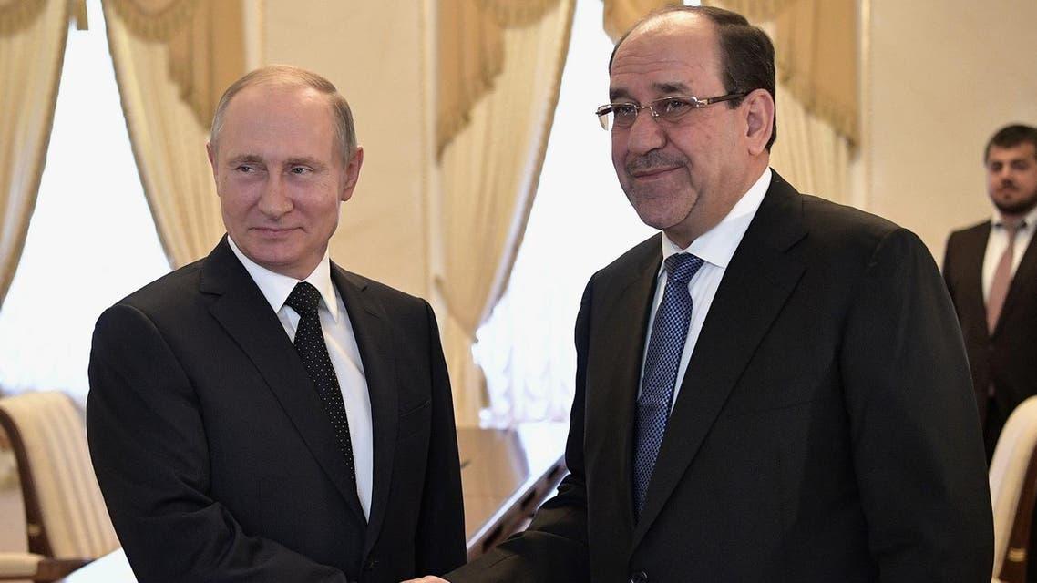 Vladimir Putin with Nuri al-Maliki during their meeting in Saint Petersburg on July 25, 2017. (AFP)