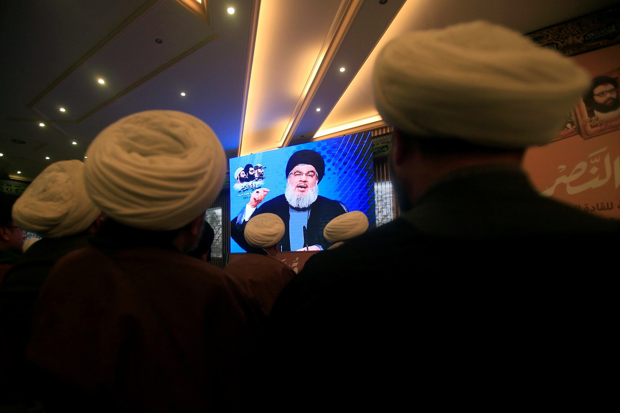 Hassan Nasrallah addresses his supporters through a screen during a rally in Jebshit village, southern Lebanon, on February 16, 2017. (Reuters)
