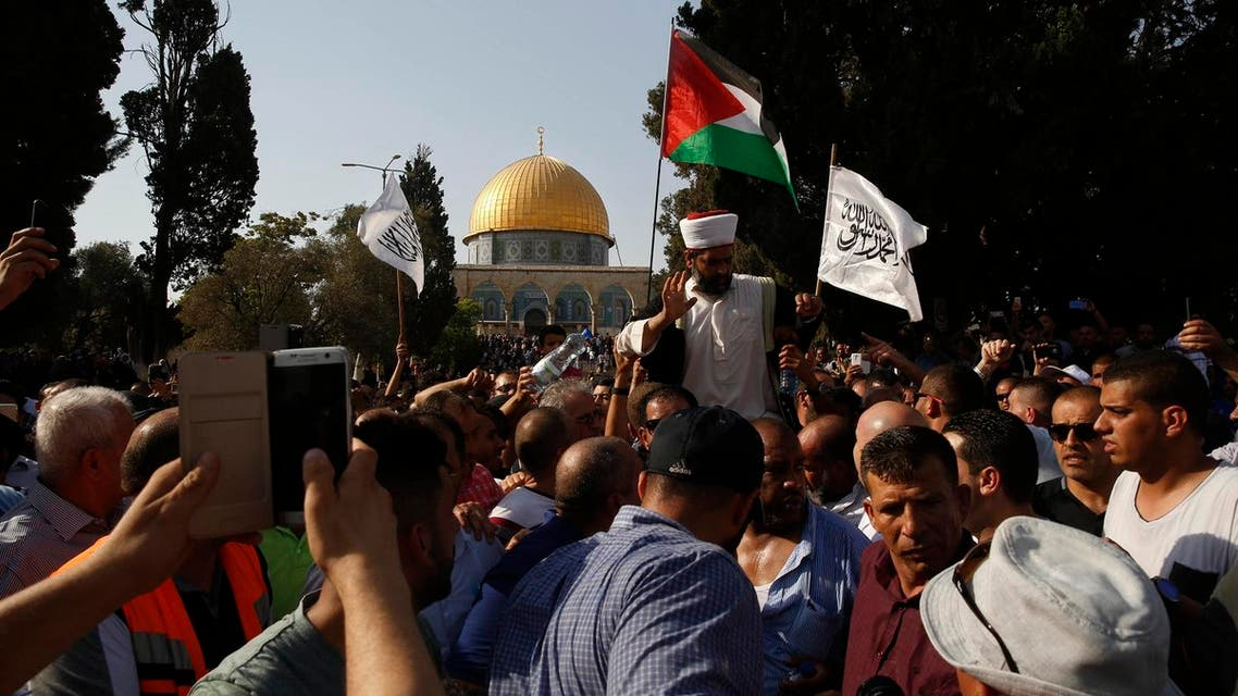 Palestinians are seen inside the Al Aqsa Mosque compound in Jerusalem's Old City on Thursday, July 27, 2017. (AP)