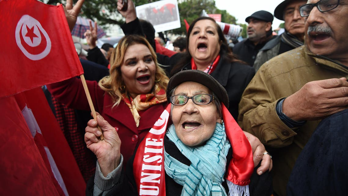 Tunisian women shout slogans against terror attacks and against allowing jihadists back into the country during a demonstration on Habib Bourguiba Avenue in Tunis on January 8, 2017. (afp)