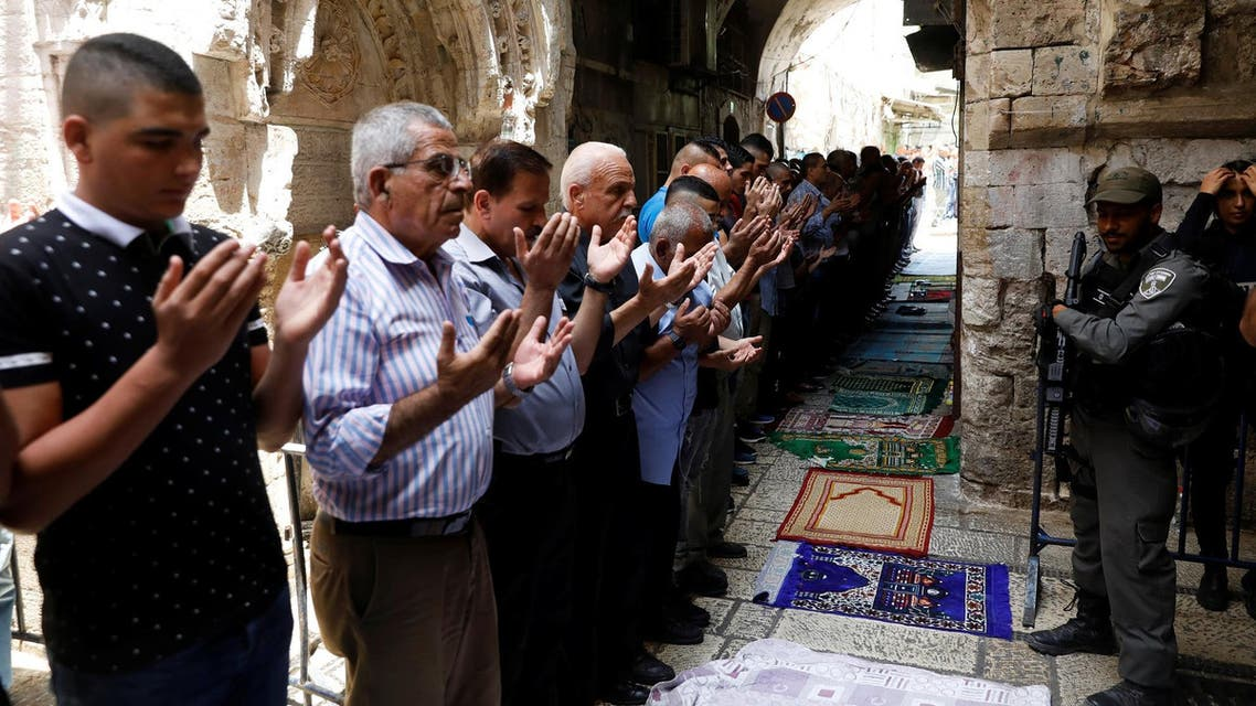 Palestinian men pray as Israeli security forces secure outside the al-Aqsa Mosque compound, in Jerusalem's Old City July 26, 2017. (Reuters)