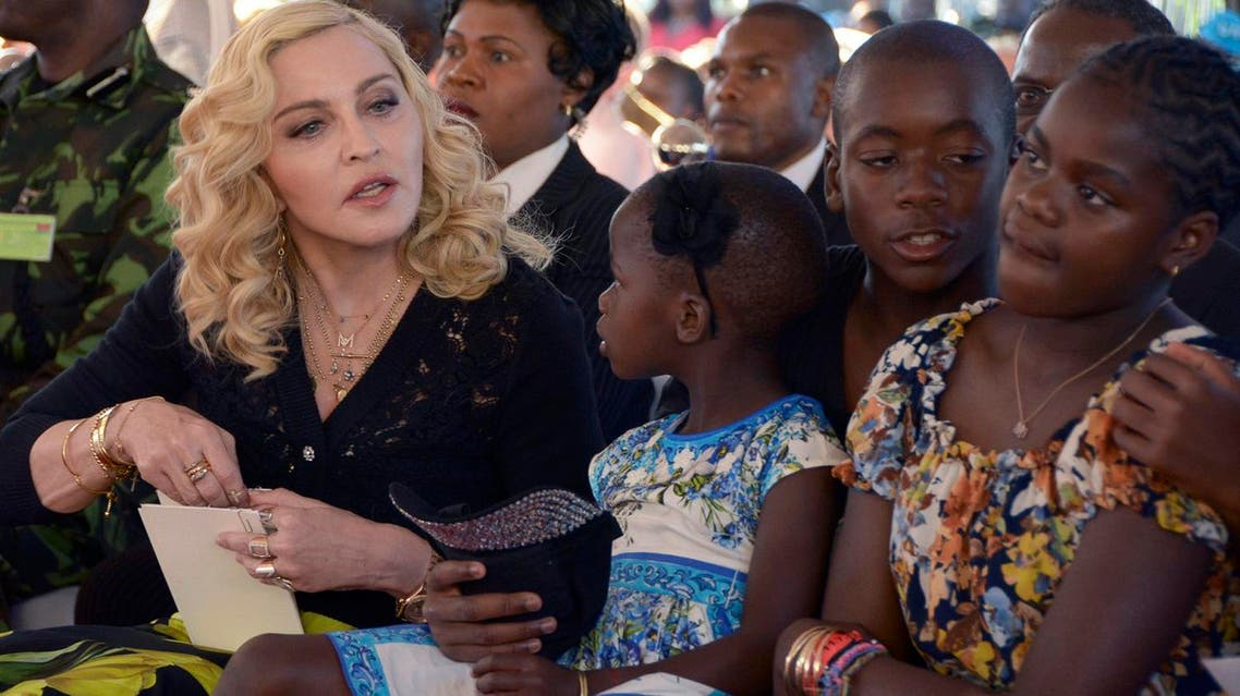 US musician Madonna with her adopted children Stella, David and Mercy, at the opening of The Mercy James Institute for Pediatric Surgery and Intensive Care, in the city of Blantyre, Malawi, on July 11, 2017. (AP)