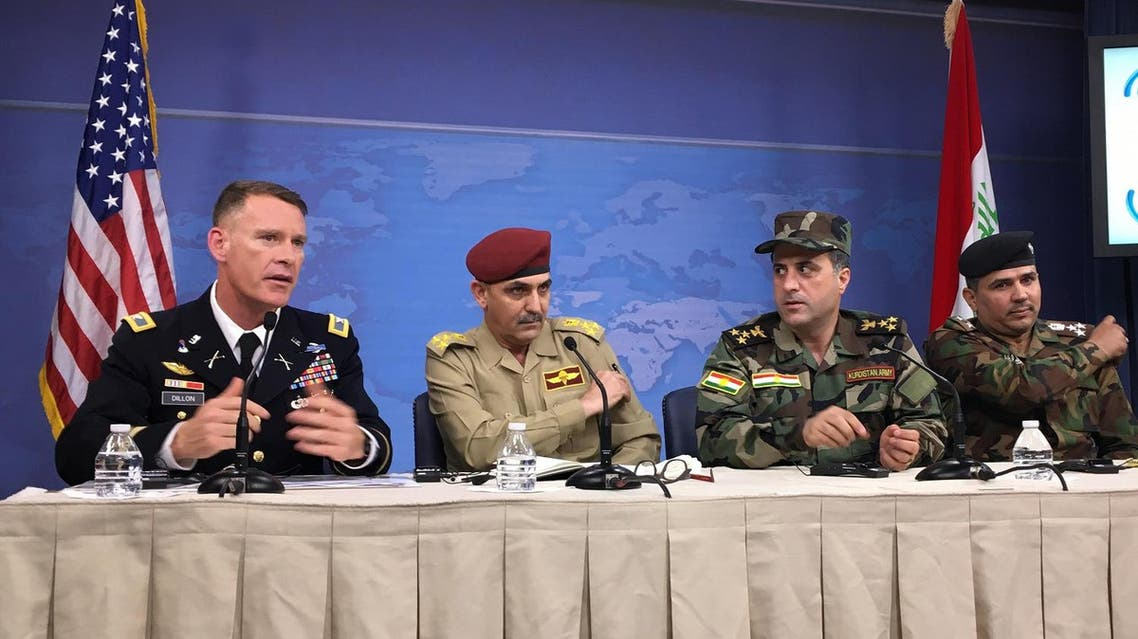 Colonel Ryan Dillon (L) speaks during a press conference at the Pentagon in Washington, DC on July 13, 2017. (AFP)