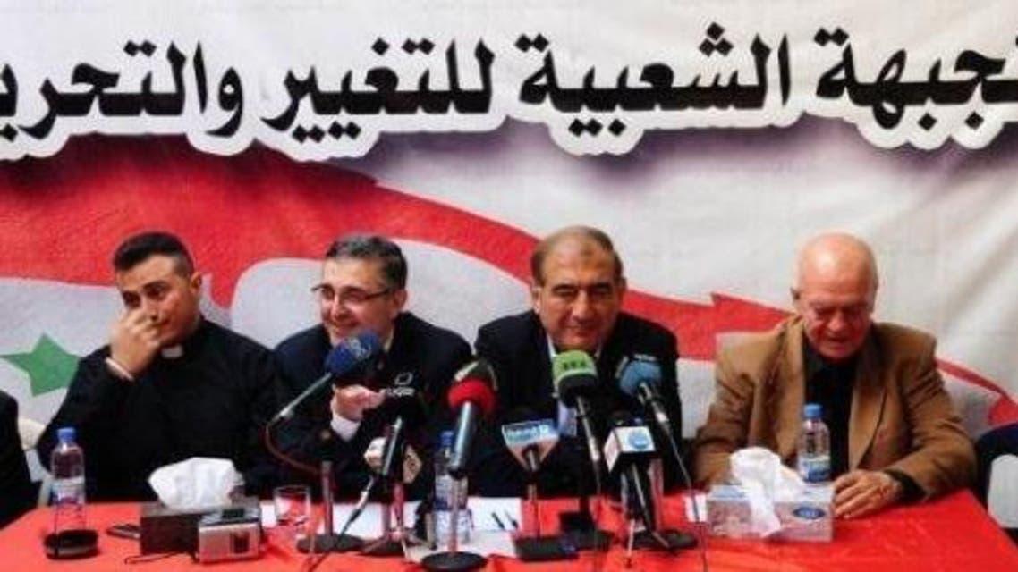 الثاني من اليمين قدري جميل رئيس منصة موسكو. يليه علي حيدر وزير في حكومة الأسد