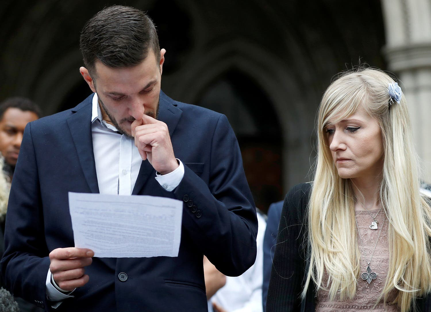 Charlie Gard's parents Connie Yates and Chris Gard read a statement at the High Court after a hearing on their baby's future, in London, Britain July 24, 2017. (Reuters)