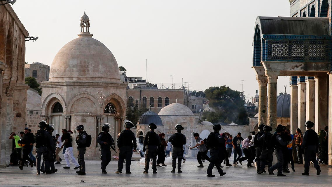 Israeli security forces fire tear-gas to disperse Palestinians after clashes broke out inside Al-Aqsa mosque's compound in Jerusalem's Old City on July 27, 2017. (AFP)