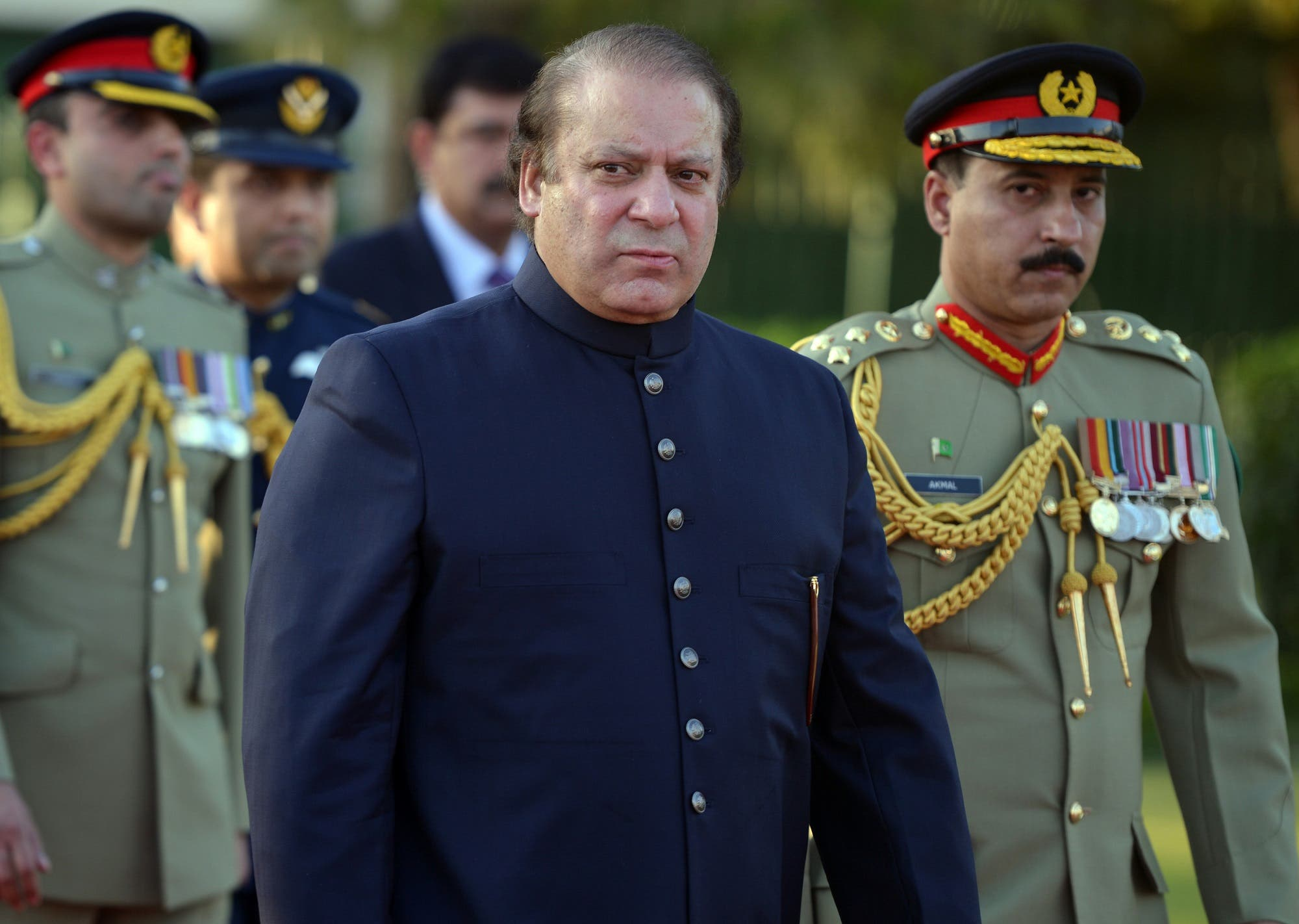 In this file photograph taken on June 5, 2013, Nawaz Sharif looks on after inspecting a guard of honor during a welcoming ceremony in Islamabad. (AFP)