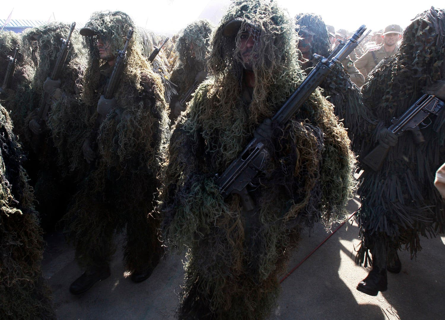 Wearing ghilli suits, Iranian army troops march during a parade marking the 30th anniversary of outset of the 1980-88 Iran-Iraq war, just outside Tehran, on Sept. 22, 2010. (AP)