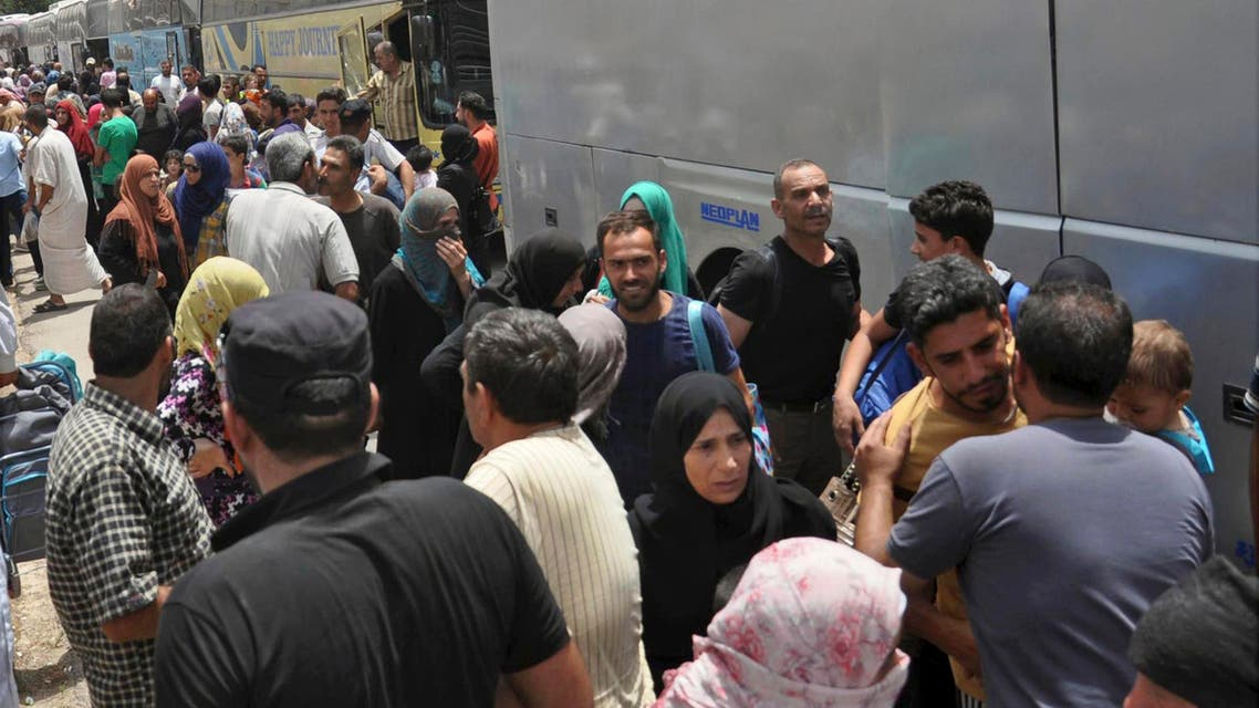 This photo released Tuesday, July 11, 2017 by the Syrian official news agency SANA, shows Syrians arriving from Jarablus, in Aleppo province, to their old neighborhood of al-Waer, in Homs, Syria. (AP)