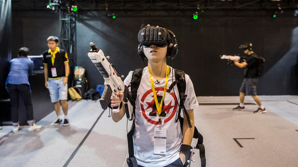 A gamer tries a virtual reality (VR) game as comic book and gaming fans attend the annual Ani-Com and Games Fair in Hong Kong on July 28, 2017. (AFP)