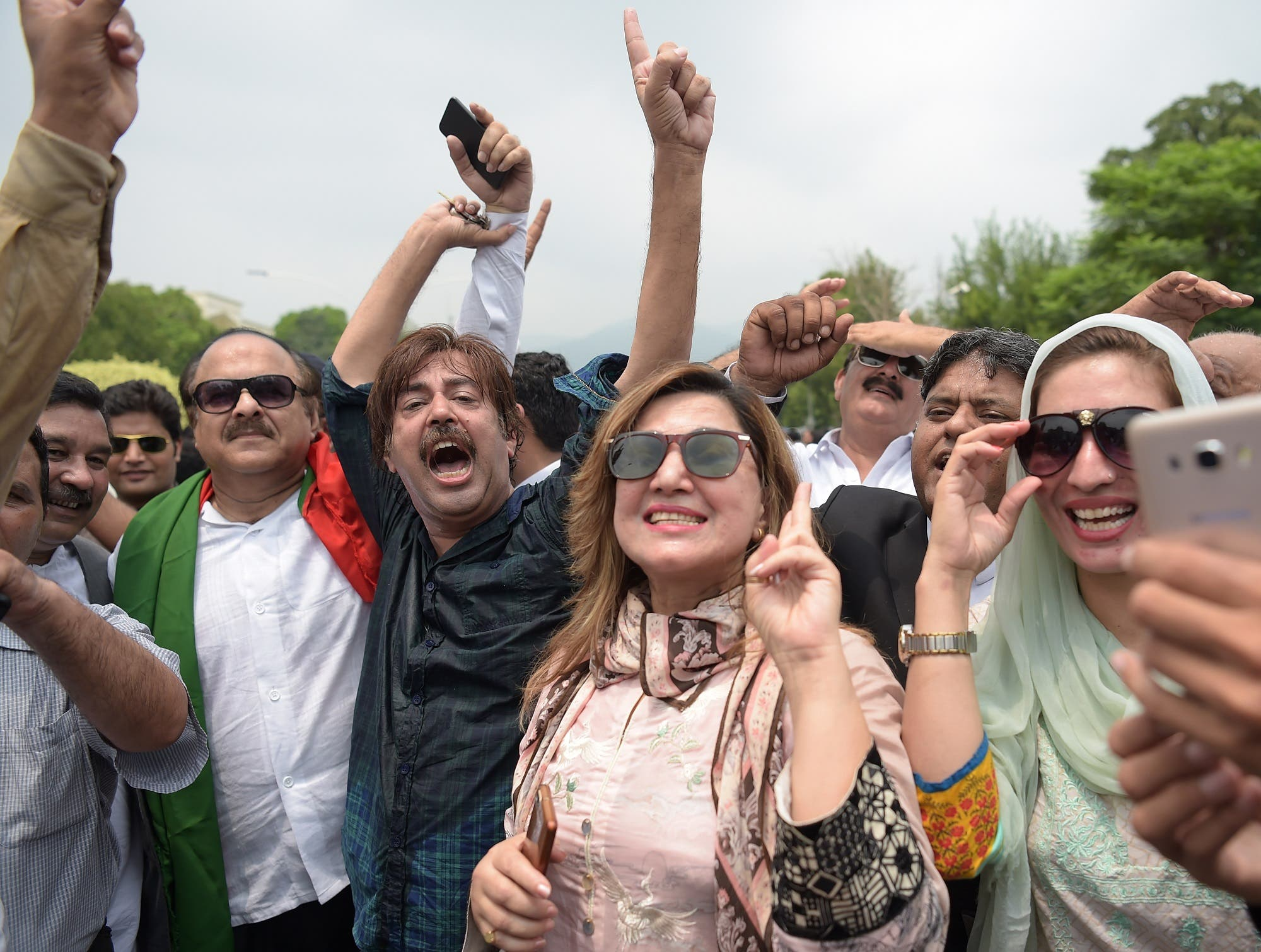 Opposition supporters of Imran Khan's Pakistan Tehreek-i-Insaf (PTI) party celebrate after the verdict in Islamabad on July 28, 2017. (AFP)