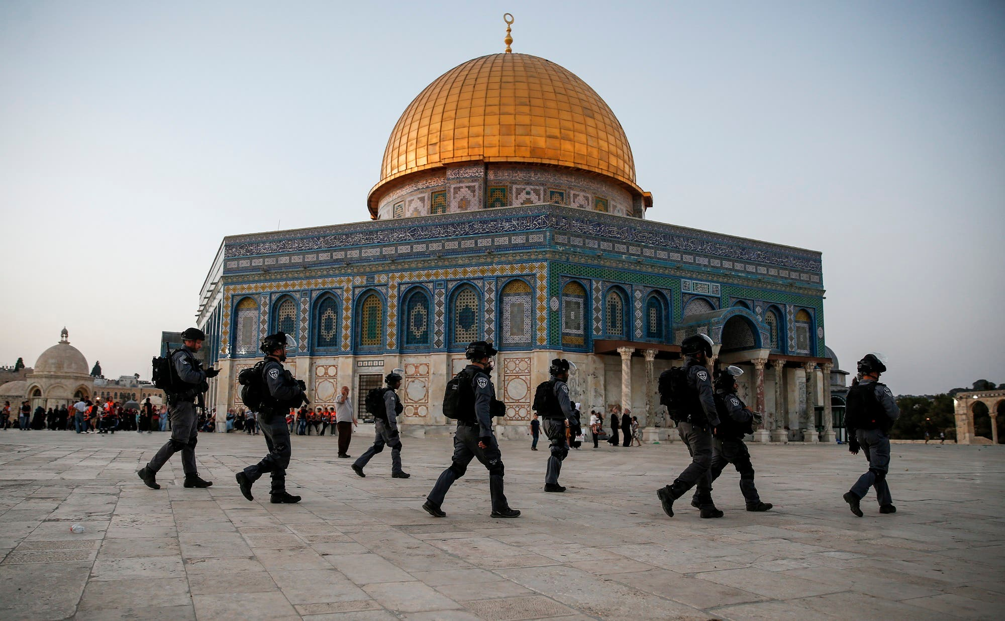 Members of the Israeli security forces walk past the al-Aqsa compound in the Old City of Jerusalem on July 27, 2017. (AFP)