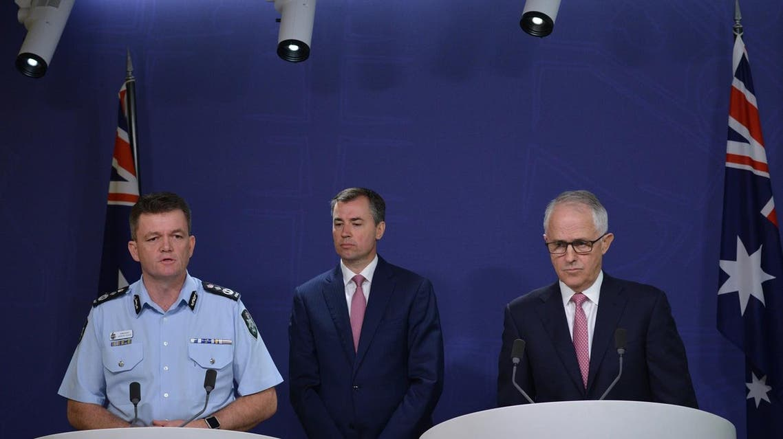 Australian Federal Police Commissioner Andrew Colvin (left), Australia's Minister for Justice Michael Keenan (center) and Australian Prime Minister Malcolm Turnbull (right) attend a press conference about an alleged terror plot in Sydney on December 23, 2016. (AFP)