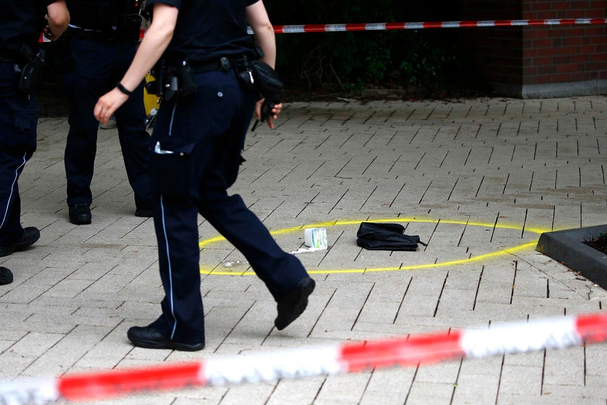 A police officer walks past crime scene after a knife attack in a supermarket in Hamburg. (Reuters)