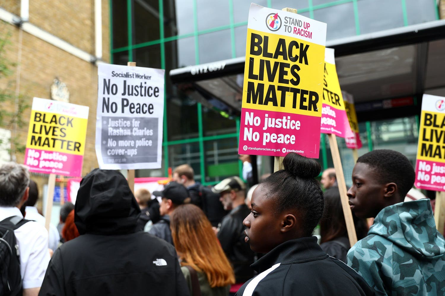 Demonstrators gather at a protest outside Stoke Newington police station over the death of Rashan Charles, London, Britain July 29, 2017. REUTERS