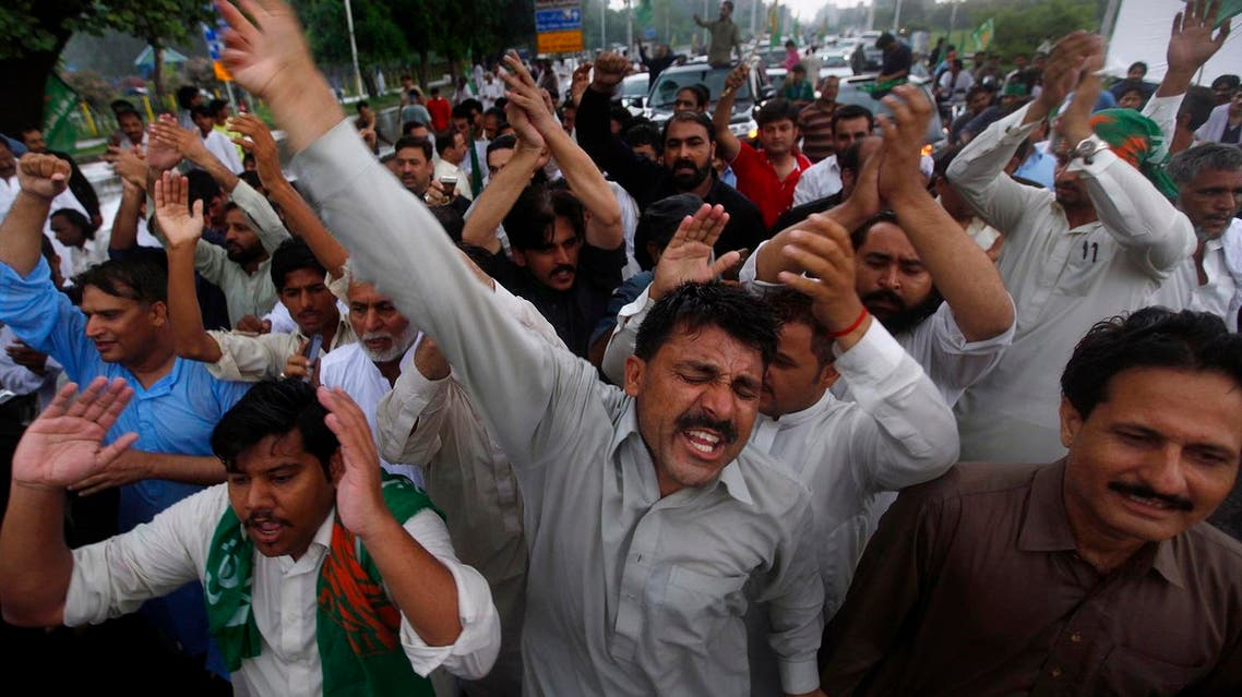 Supporters of Pakistan's deposed Prime Minister Nawaz Sharif chant slogans at a rally to to condemn the dismissal of their leader, in Islamabad on July 29, 2017. (AP)