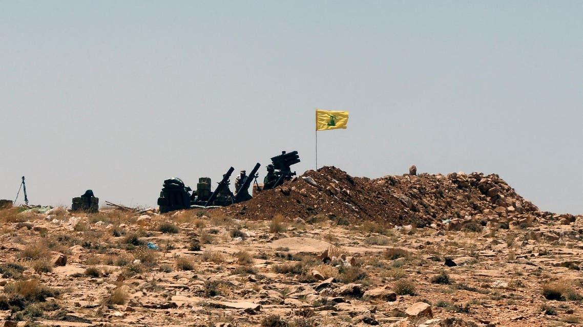 A Hezbollah flag is seen at Juroud Arsal, Syria-Lebanon border