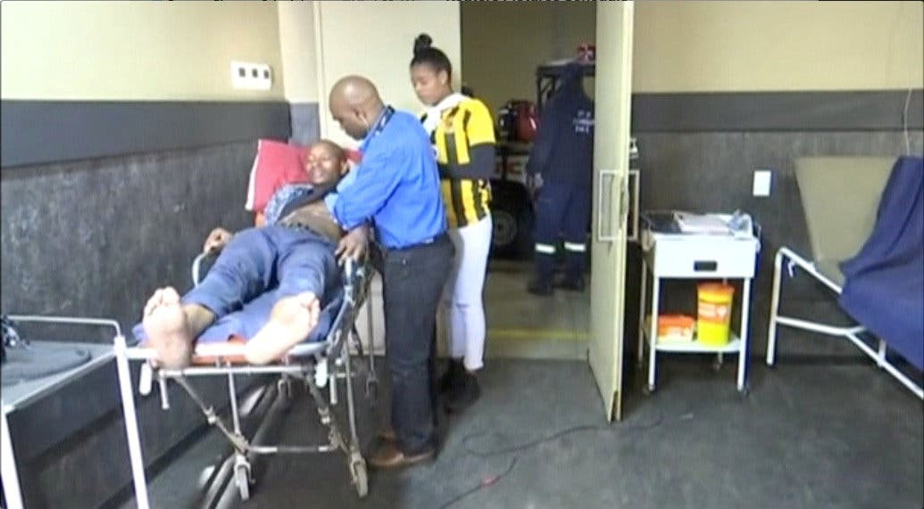 A man who was injured during a stampede at South Africa's FNB Stadium is attended to by paramedics in Soweto, Johannesburg. (Reuters)