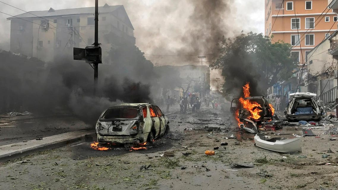 Vehicles burn at the scene of an explosion in Mogadishu, Somalia, July 30, 2017. REUTERS/Feisal Omar