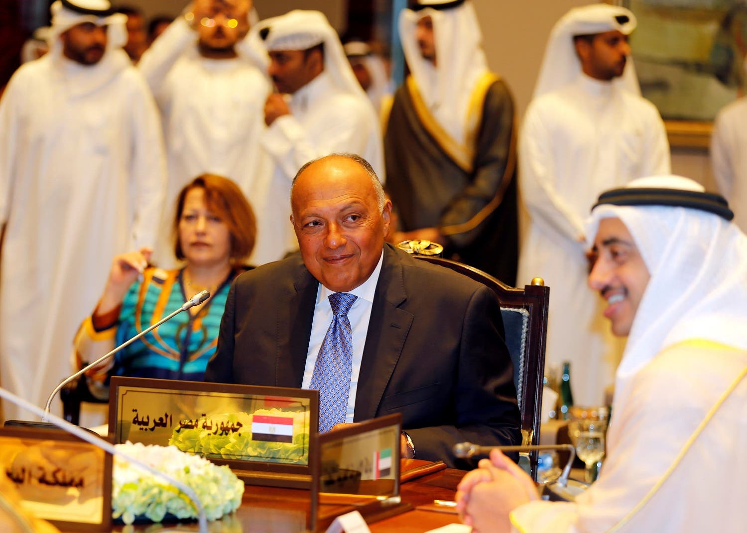 Egypt's Foreign Minister Sameh Shoukri and UAE Foreign Minister Sheikh Abdulla bin Zayed bin Sultan Al Nahyan talk as foreign ministers of Saudi Arabia, Bahrain, the UAE and Egypt meet in Manama, on July 30, 2017. (Reuters)