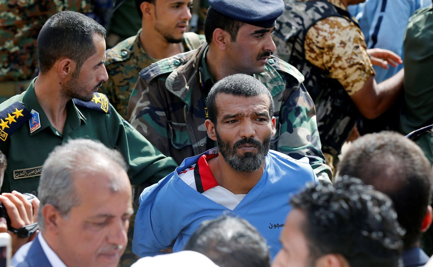 Police officers escort Muhammad al-Maghrabi to the execution site, in Sanaa. (Reuters)