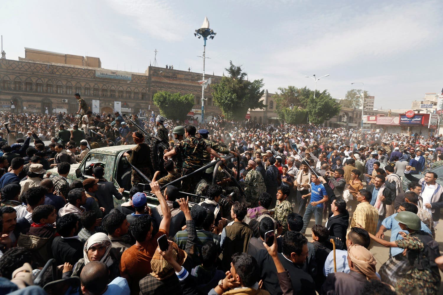 People and police troopers gather at the site of the execution of Muhammad al-Maghrabi. (Reuters)