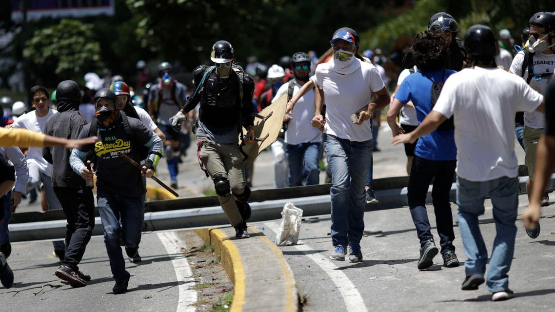 Demonstrators run as clashes broke out with security forces while the Constituent Assembly election was being carried out in Caracas, Venezuela, July 30, 2017. REUTERS/Ueslei Marcelino
