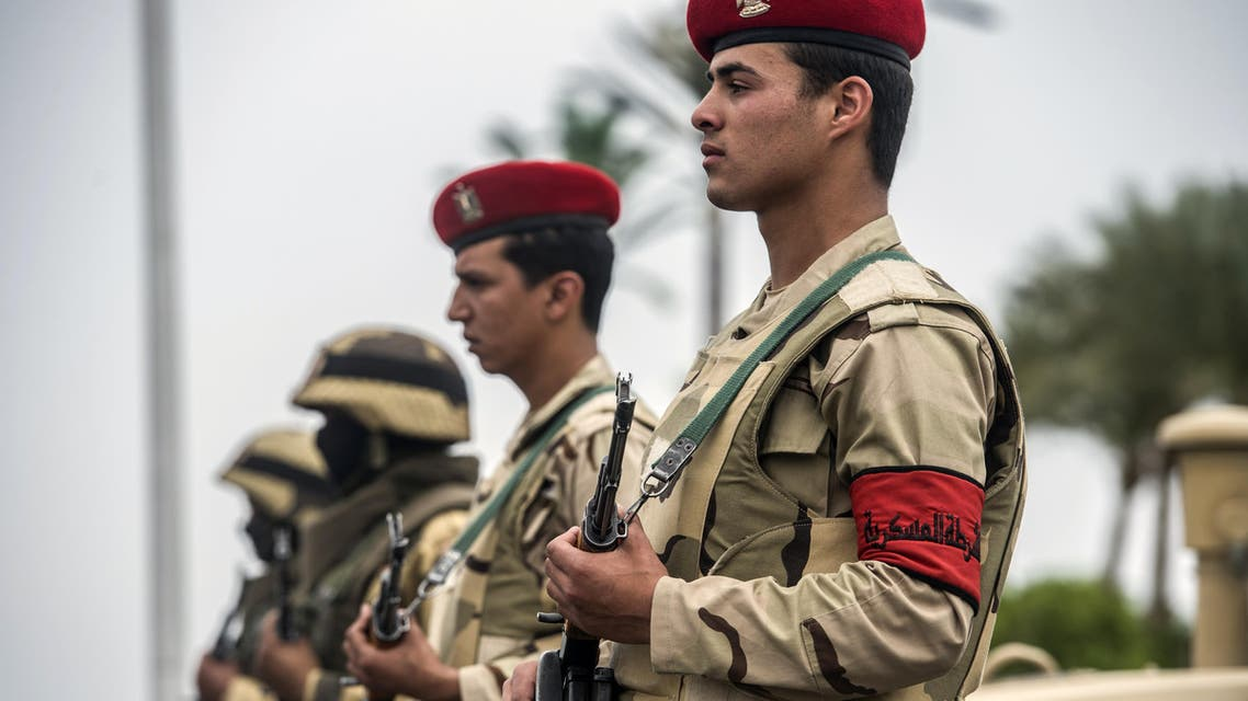 Members of the Egyptian army stand guard outside the venue of a conference for defence ministers and officials of the 27 members of CEN-SAD in Egypt's Red Sea resort of Sharm el-Sheikh on March 24, 2016. AFP