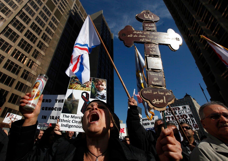 Almas Shaya, a member of Michigan's Chaldean community, who are Iraqi Catholics, rally in Detroit Monday, Nov. 8, 2010. (AP)