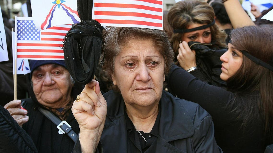 A protester fights back tears calling on the American and Iraqi governments to protect Iraqi Christians during a downtown rally November 8, 2010 in Chicago, Illinois. (AFP)
