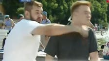 Russian TV reporter punched in the face live on air