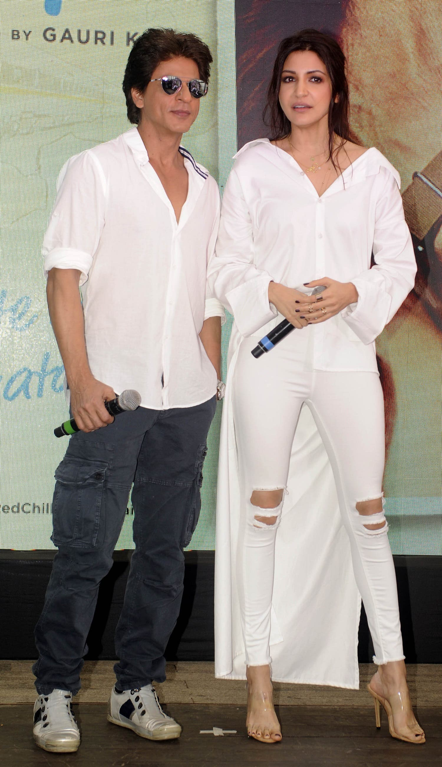 Shah Rukh Khan and Anushka Sharma pose for a photograph during a promotional event for the forthcoming Hindi film 'Jab Harry Met Sejal' in Mumbai on July 26, 2017. (AFP)